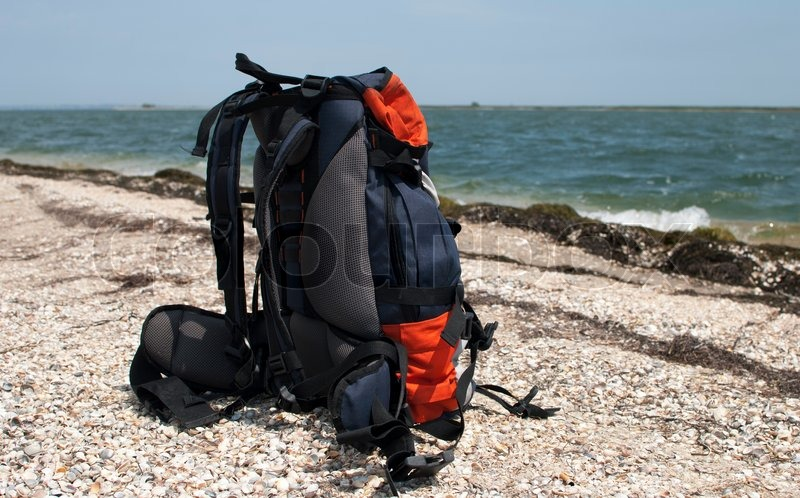Tourist backpack on the sea coast  0d8bb6913d626
