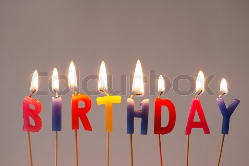 Burning candles with the word Birthday Stock Photo Colourbox