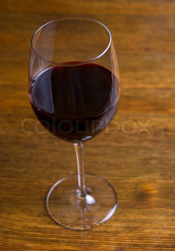 red wine glass over at wooden table background stock photo colourbox. Black Bedroom Furniture Sets. Home Design Ideas