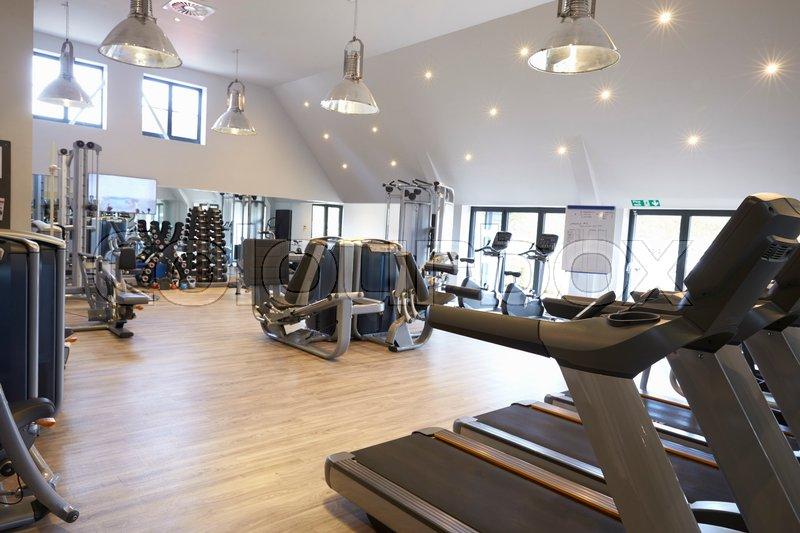 Empty gym with modern fitness equipment, stock photo