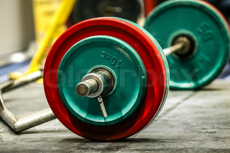 Sports bar on wood floor for deadlift on competition powerlifting, stock photo