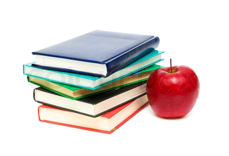 stack of books and red apple closeup isolated on white background