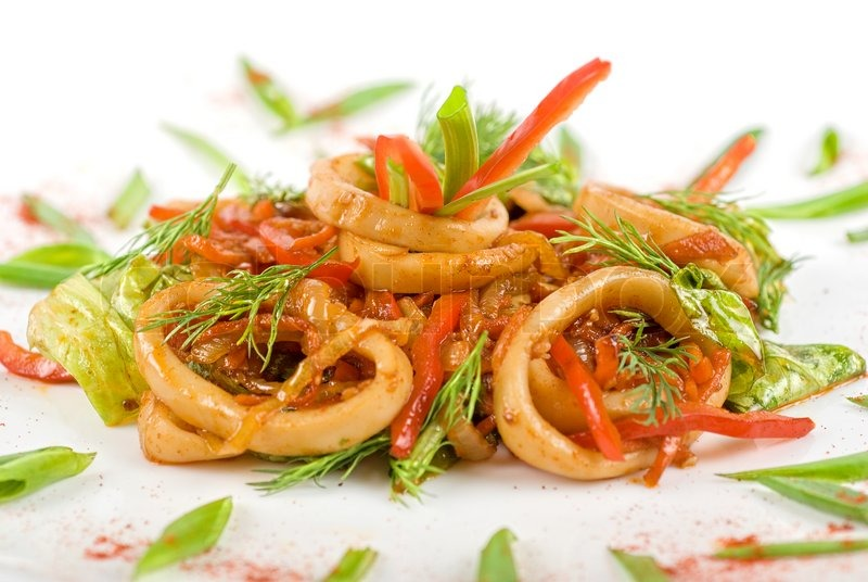 Stock image of 'Seafood salad with squid and vegetables closeup'