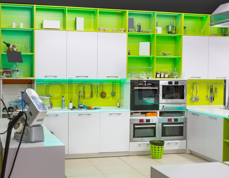 Modern kitchen interior with green colored furniture, stock photo