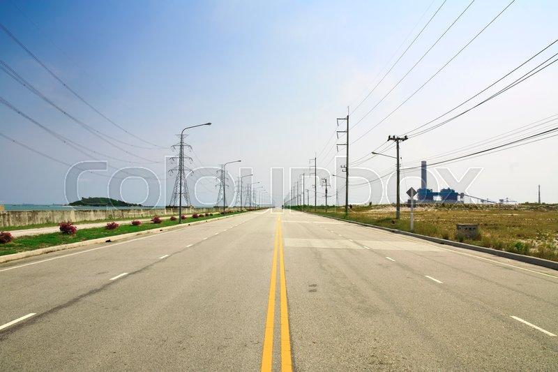 Road & transmission line in industrial estate at Maptaphut, stock photo
