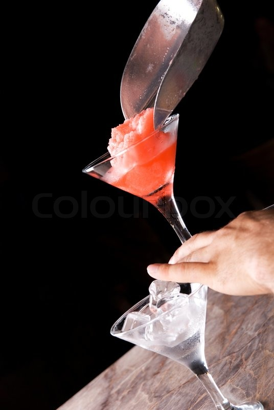 Preparation of frozen cocktail on the wooden bar stock for Cocktail preparation