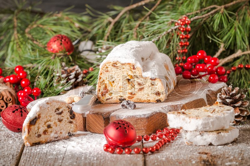 traditional german christmas cake on a rustic festive table stock photo colourbox