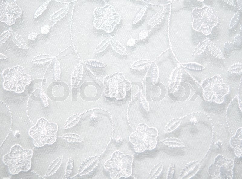 Texture Of The Wedding Dress Of Embroidered Flowers