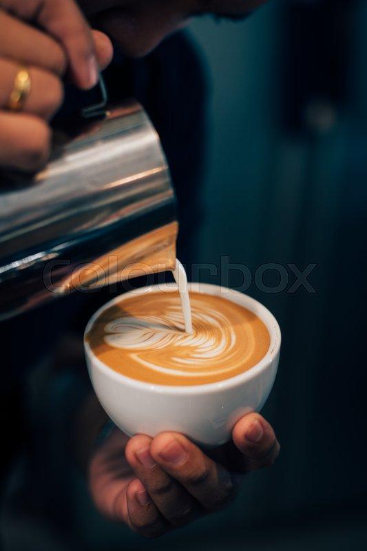 Coffee latte art in coffee shop vintage color tone, stock photo