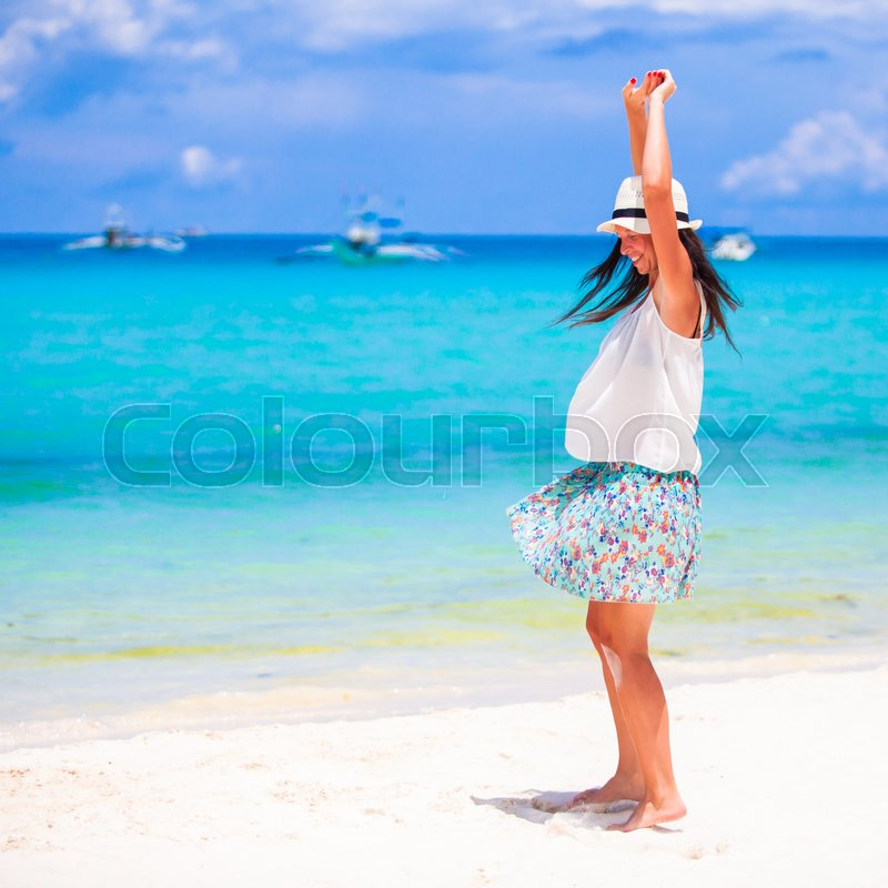 Happy beautiful woman during beach tropical vacation, stock photo