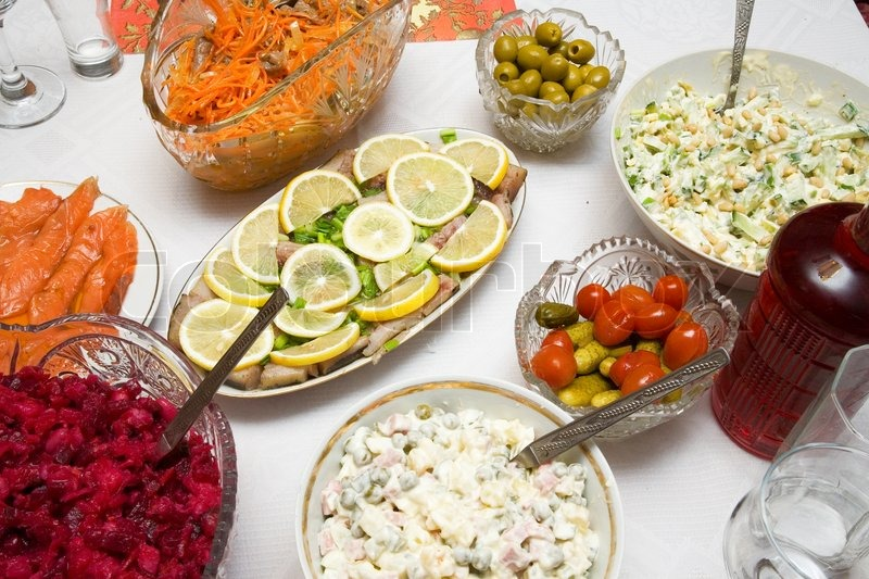 festive christmas dinner salads and snacks mooseberry vodka stock photo