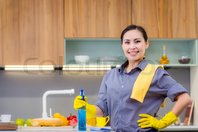Young beautiful asian woman housekeeping in the kitchen, stock photo