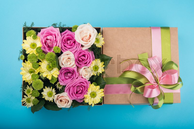 Beautiful gift box with flowers. wedding decoration accessory. blue background, stock photo