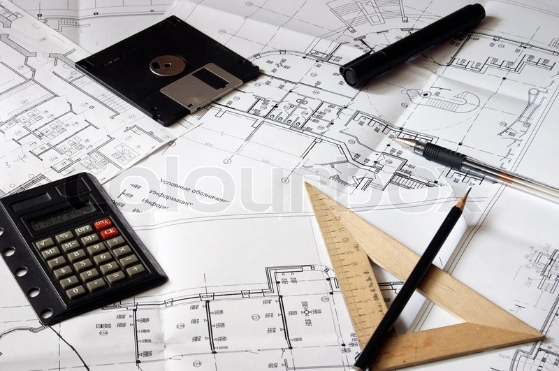 Construction blueprints and drawing tools, stock photo
