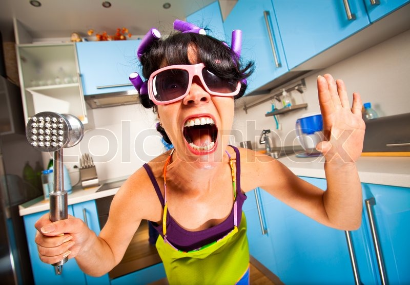 Exceptional Crazy Housewife In An Interior Of The Kitchen | Stock Photo | Colourbox