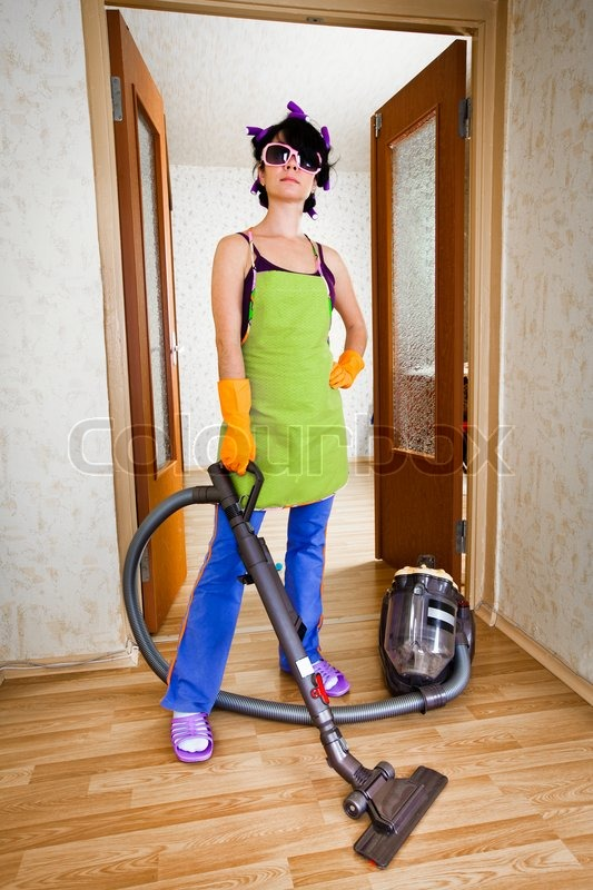 housewife costs in apartment with a vacuum cleaner stock