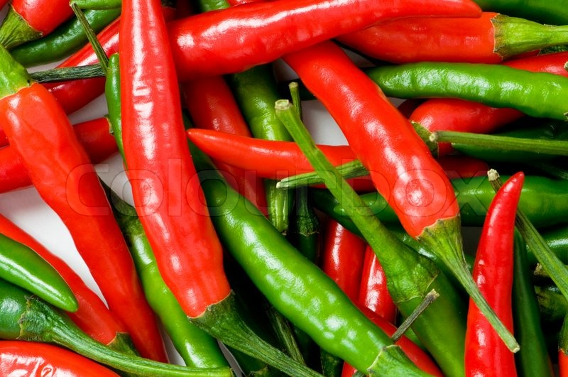 Red and green chili peppers at the background | Stock ...
