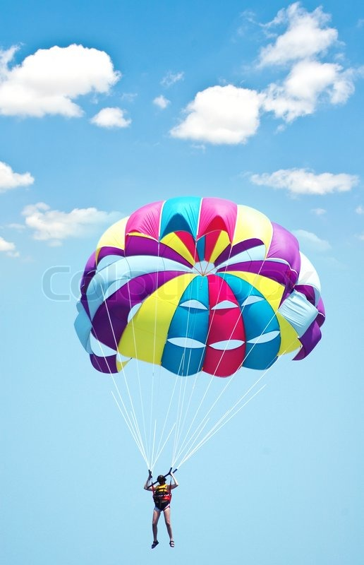 Multi coloured parachute over the blue sky   Stock Photo ... People Falling Over