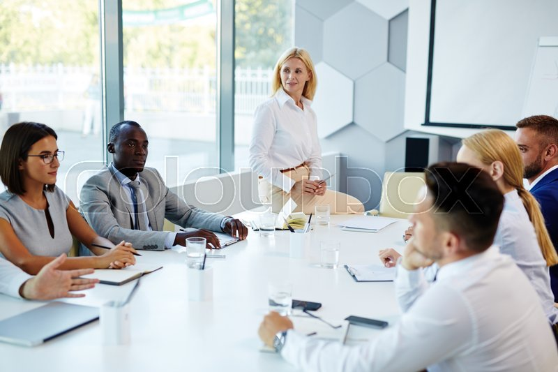 Young adults interacting at business training, stock photo