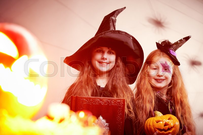 Stock image of 'Portrait of two cute withes by shining Jack  Lantern'