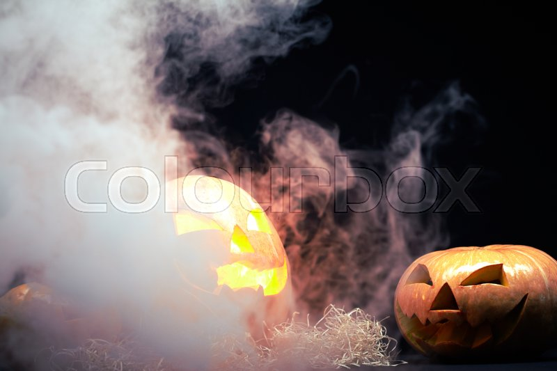 Stock image of 'Halloween pumpkin burning and smoking'