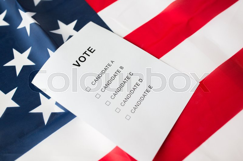 Stock image of 'voting, election and civil rights concept - empty ballot or vote on american flag'