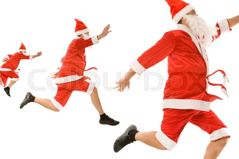Stock image of 'Image of three santa clauses  hurrying for xmas'