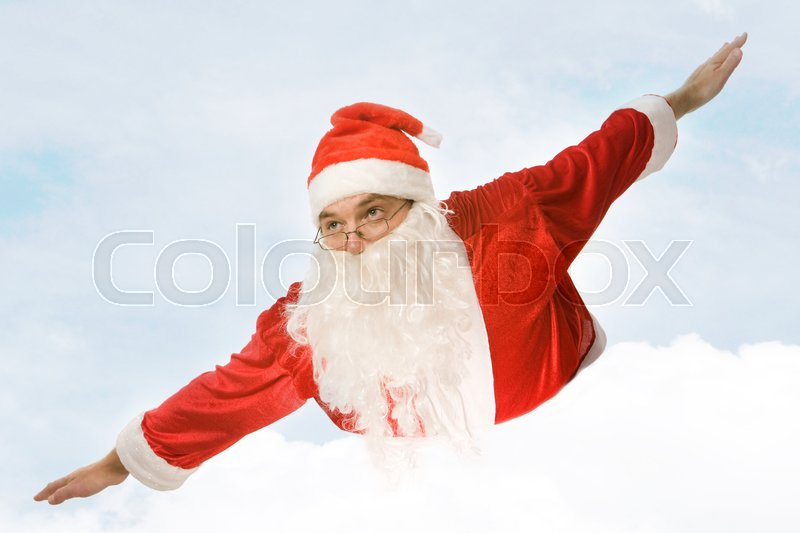 Stock image of 'Photo of santa claus flying on the background of sky'