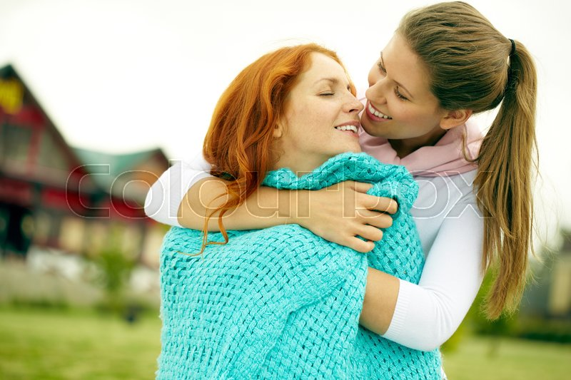 Stock image of 'Portrait of two embracing passionate lesbians'