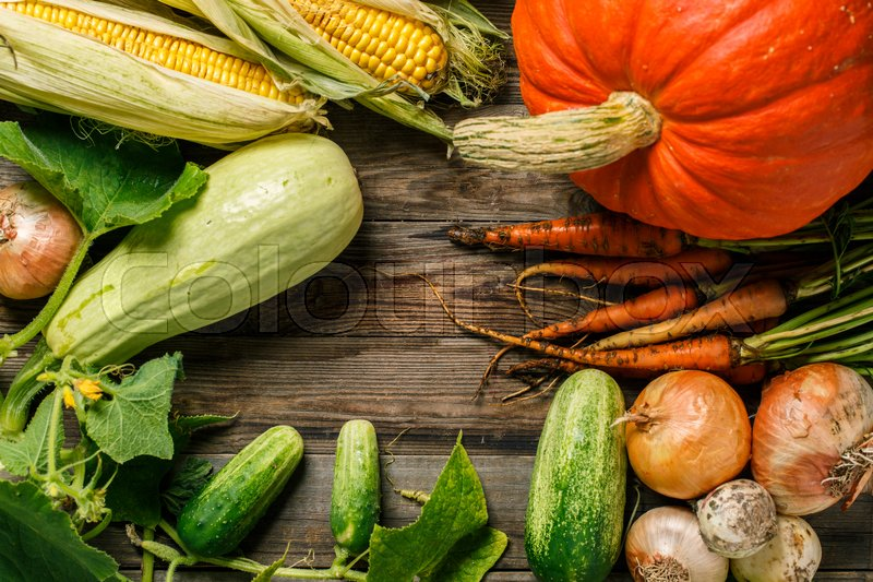 Stock image of 'Different raw vegetables on wood background. Healthy eating.'