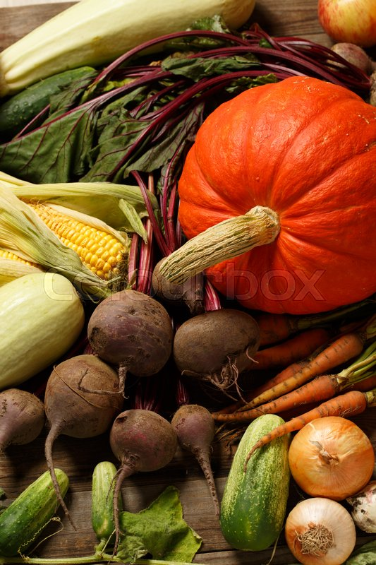 Stock image of 'Close-up of various vegetables on wooden board'