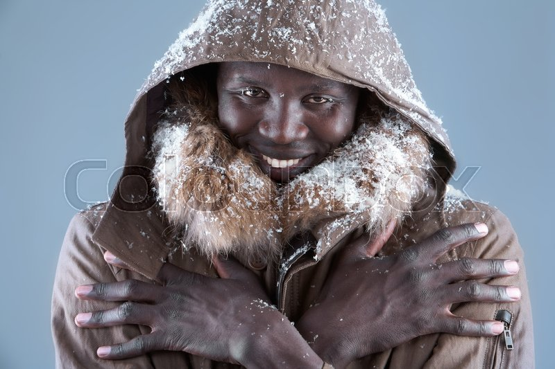 Stock image of 'Fashion model in winter coat looking at camera'
