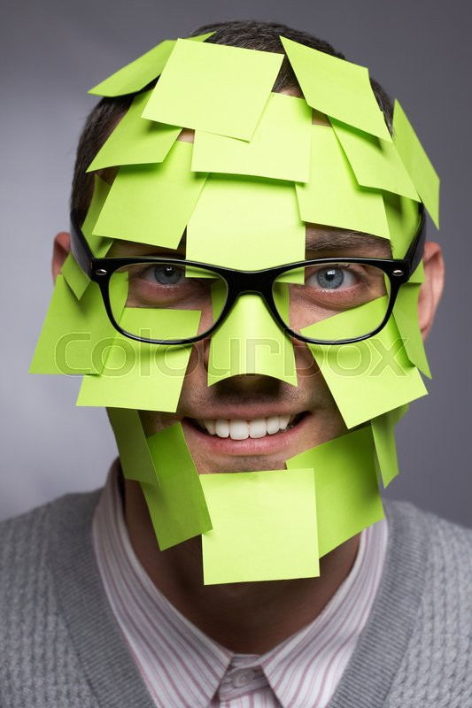 Stock image of 'Portrait of a man in glasses covered with adhesive notes'