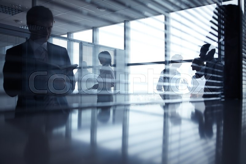Stock image of 'Reflection of business people working in office'