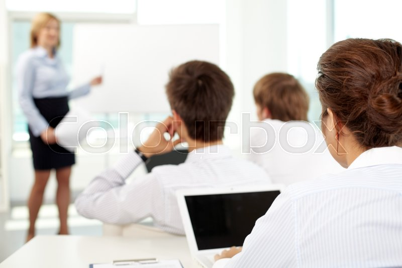 Stock image of 'Business people sitting at seminar'