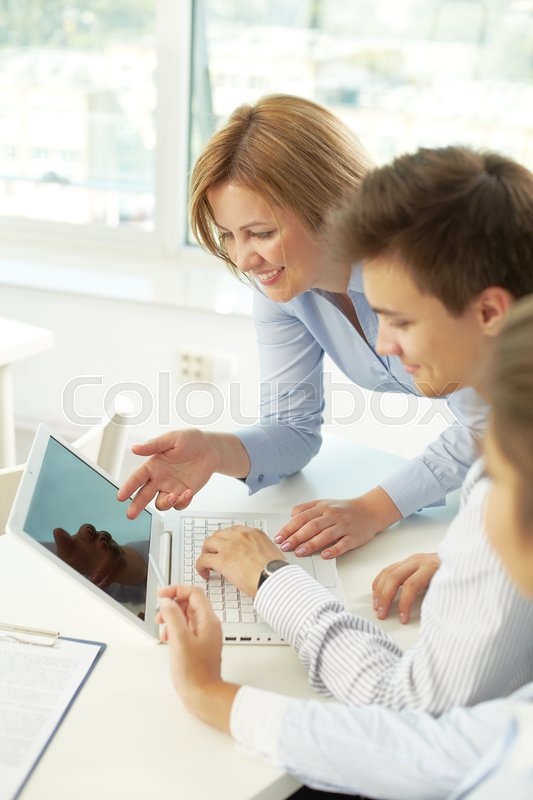 Stock image of 'Successful business team working with presentation on laptop'