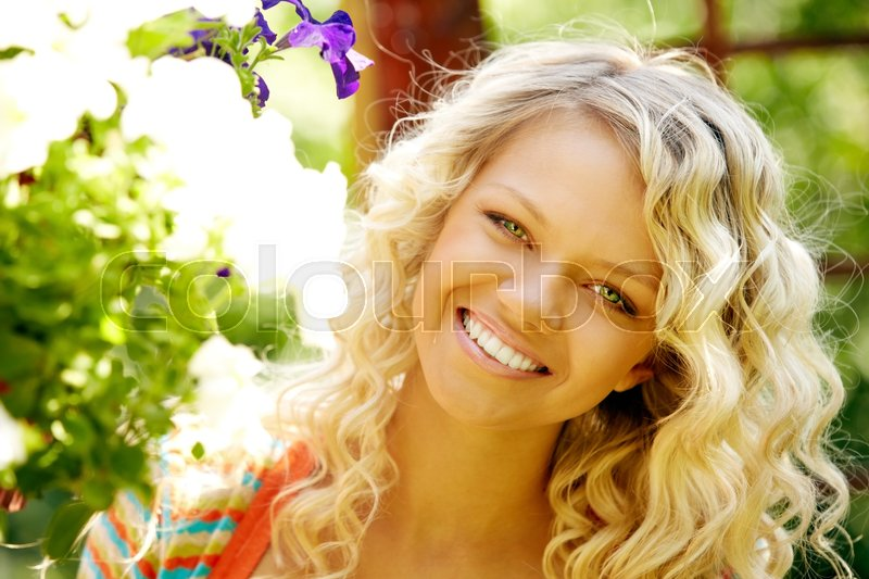 Stock image of 'Smiling beautiful blond hair woman looking at camera'