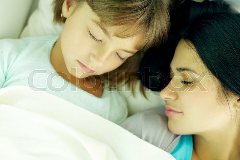 Stock image of 'Mother and daughter sleeping together'