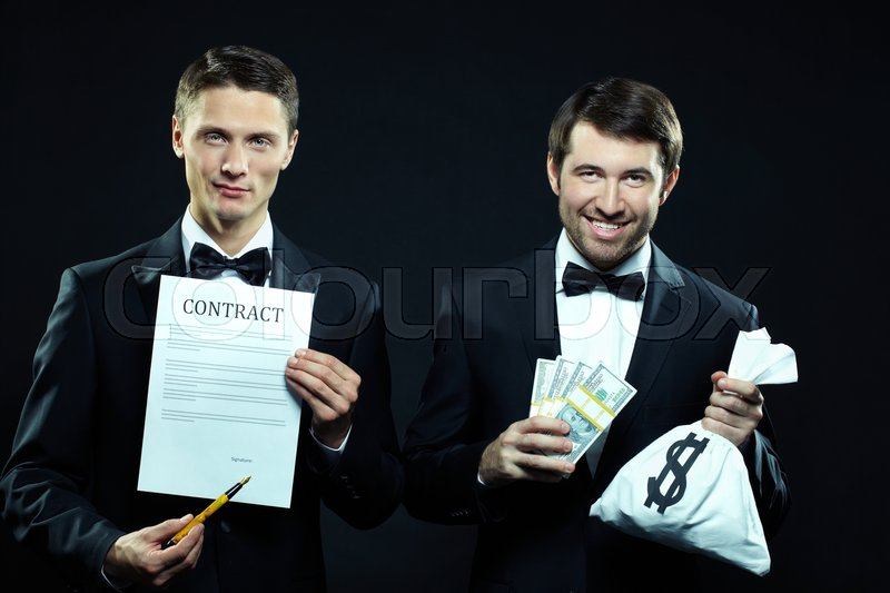 Stock image of 'Two presentable men holding contract and sack with dollars'