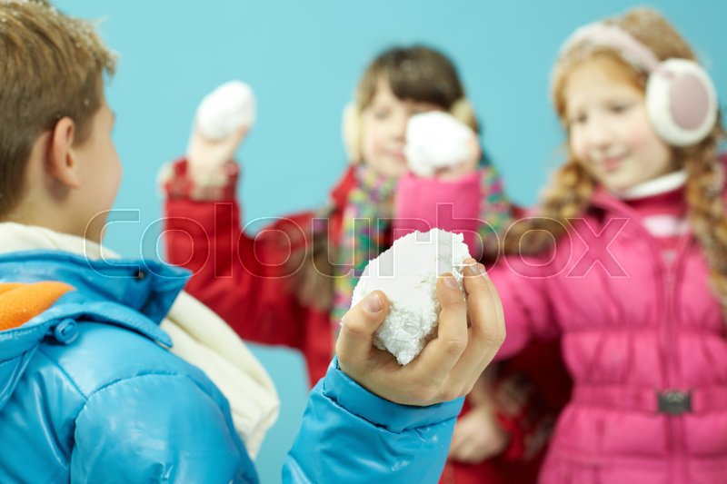 Stock image of 'Playing snowball fight'
