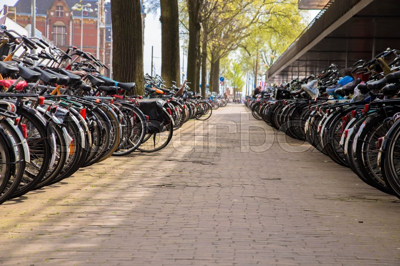 Editorial image of 'AMSTERDAM, NETHERLANDS - APRIL 22, 2016: Huge bike bicycle parking station near Amsterdam Centraal railway station'