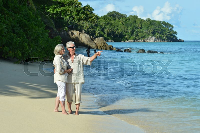 Stock image of 'Happy elderly couple rest at tropical beach'