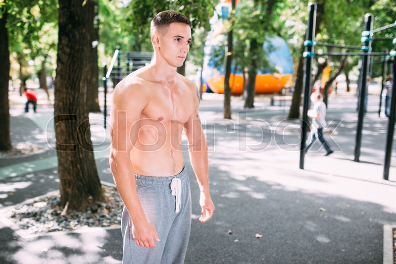 Stock image of 'Outdoor portrait of healthy handsome active man with fit muscular body, sports and fitness concept.'