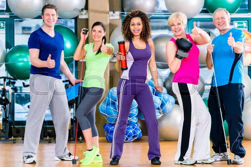 Stock image of 'Diversity fitness group in gym, old and young, black and white people, doing sport in gymnastic training'
