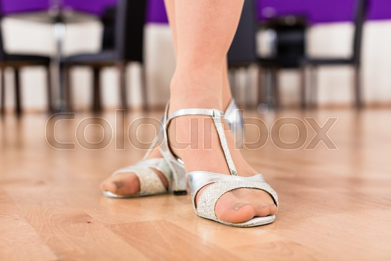 Stock image of 'Women with her dancing shoes in dance school'