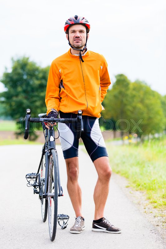 Stock image of 'Sport Cyclist with bike having break'