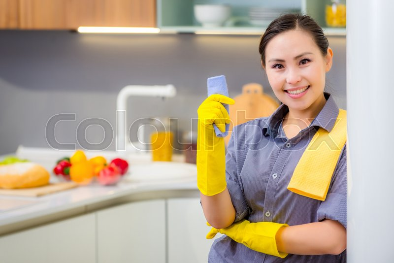 Stock image of 'Young beautiful asian woman housekeeping in the kitchen'