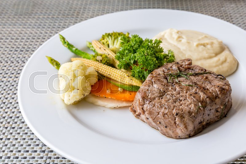 Stock image of 'grilled fillet steak served with grilled vegetable and mash potato'