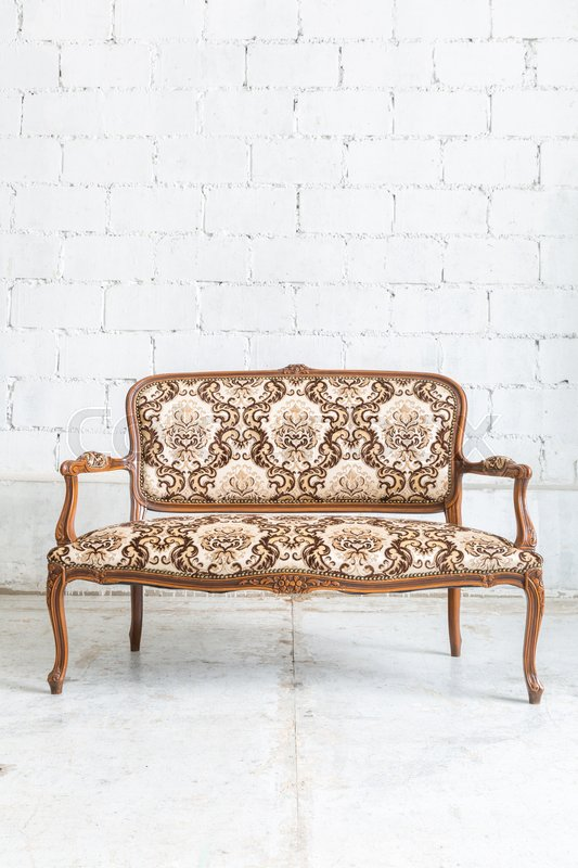 Stock image of 'Brown Classical style sofa couch in vintage room'