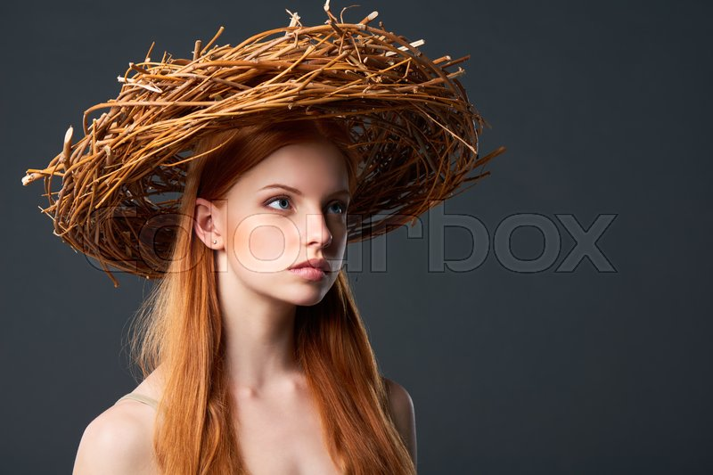 Stock image of 'Closeup of beautiful woman in natural wreath of wicker, studio portait with copy space'